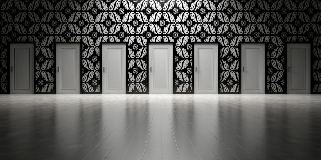 7 white doors on black patterned wallpaper